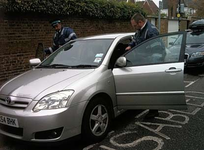 Civil Enforcement Officers issue parking icket to disabled driver after parking in her disabled bay